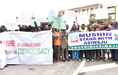 Sack National Legal Adviser Muiz Banire From APC – Prostesters
